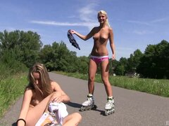 Fanciful amateur lesbian teens with nice asses and long hair having fun skating in a hot outdoor action