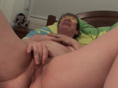 Masked mature fucks her cunt with fingers. Horny naked mature in a mask fingering and rubbing her cunt