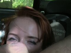 Pale redhead banged in fake taxi. Pale redhead British amateur babe wanking and sucking big cock of fake taxi driver on the backseat of his cab while they parked in woods