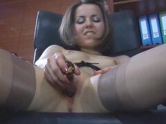 LacyNylons Video: Mishelle A. Watch this adorable nubile secretary producing a new glass dildo and putting it to use in the office. Mishelle A. will hike up her skirts revealing the tops of her bronzed suspender nylons and bare pantyless pussy. The heated babe will spread-eagle in her big leather chair, place her leg on the shelf with files and finally mount her working desk to fuck herself to orgasm wearing just her fine stockings and pumps.